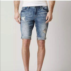 Departwest buckle distressed Bermuda jean shorts